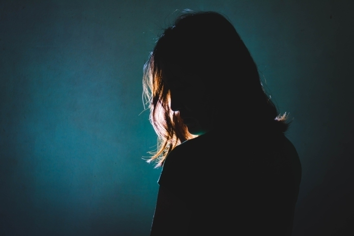 woman silhouette on dark background