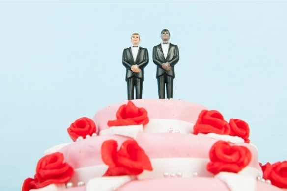 wedding cake with 2 men on the top